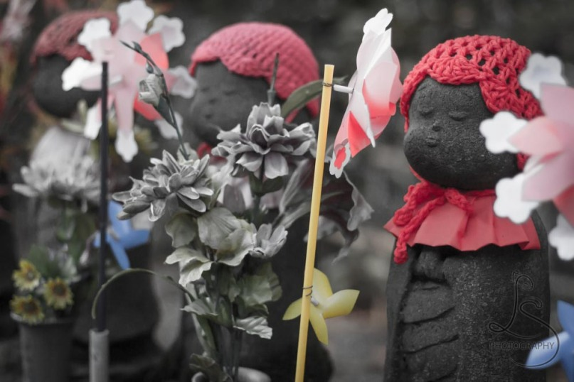 Mizuko Kuyou, memorial statues, stand outside a temple in Tokyo, Japan.
